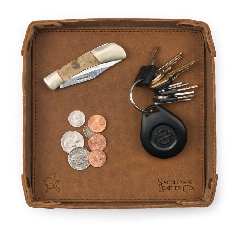 This is a tan brown leather catchall valet tray from the top.