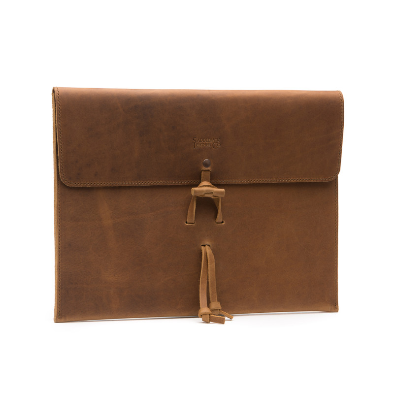 This is a tan brown leather document holder front.