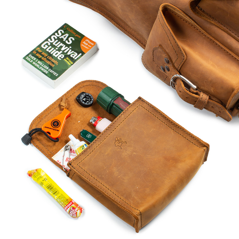 This is a small tan brown leather organizer bag made of one piece of leather with a wrap around cord to close it. It is emptied.
