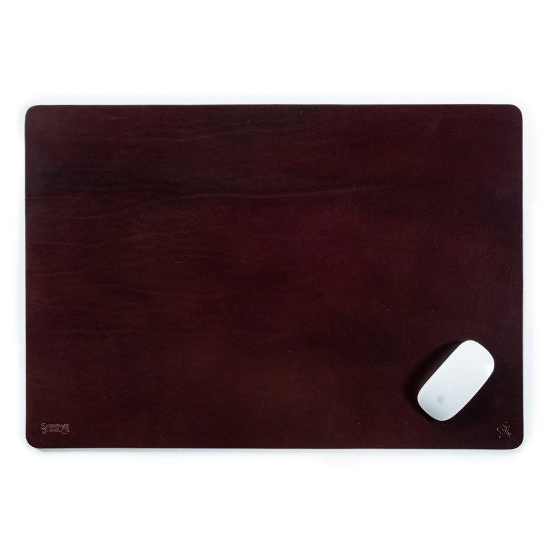 This is a dark reddish brown leather desk pad with a mouse on it.