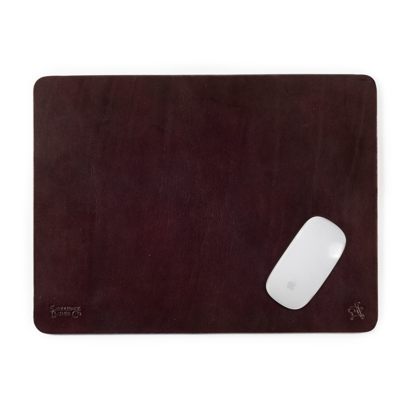 This is a dark reddish brown leather large mouse pad with a mouse on it.