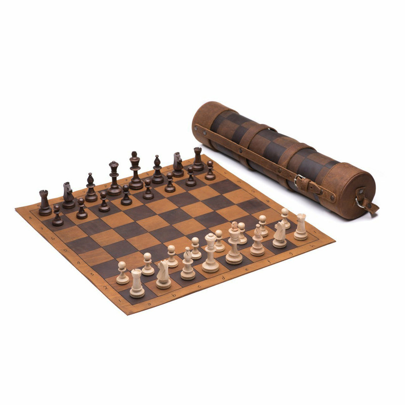 This is a leather travel chess set that is rolled up with a shoulder strap over the shoulder and also open and set up.