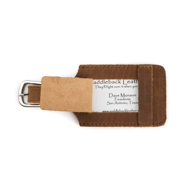 This is a tan brown leather luggage tag that is open to  be an ID Badge Holder.