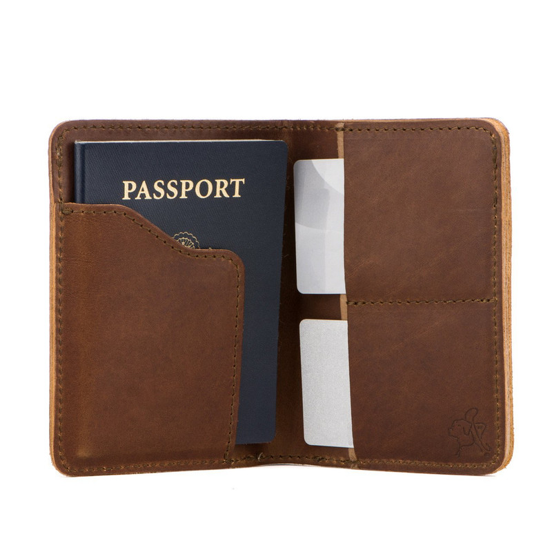This is the inside of a tan brown leather passport wallet.