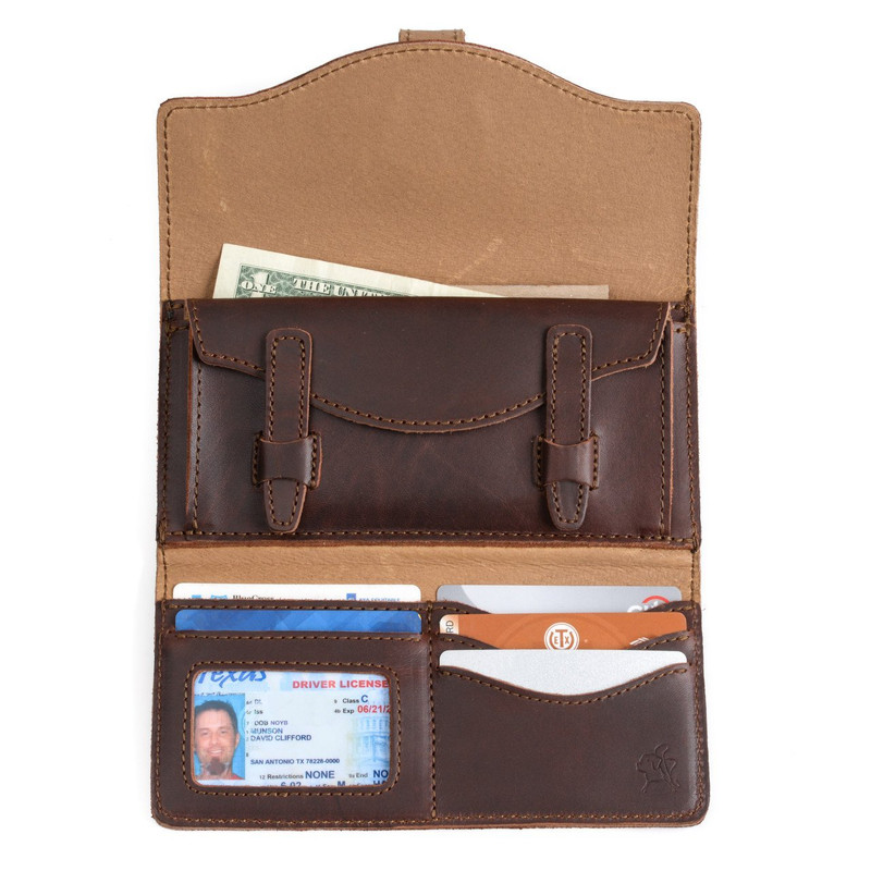 This is the inside of a dark brown long trifold leather wallet for passports.