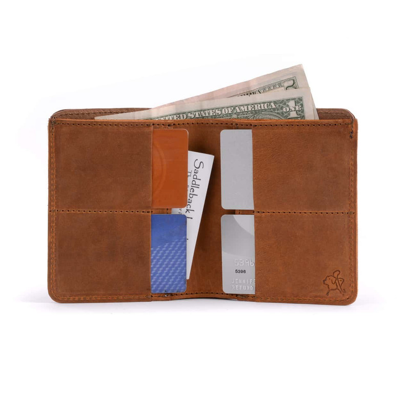 This is the inside of a tan brown large bifold leather wallet.