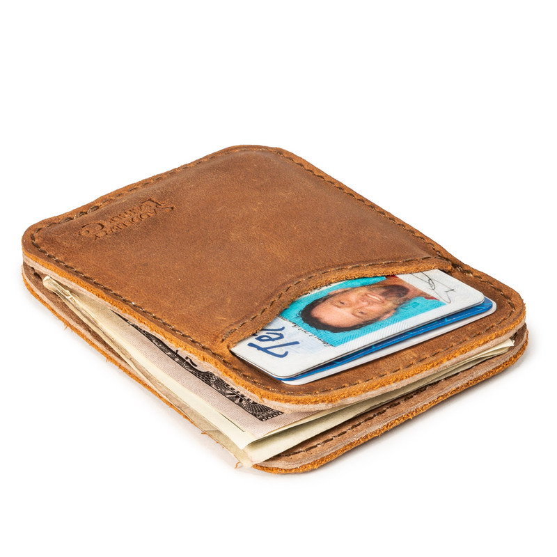 This is a tan brown leather wallet laying down.
