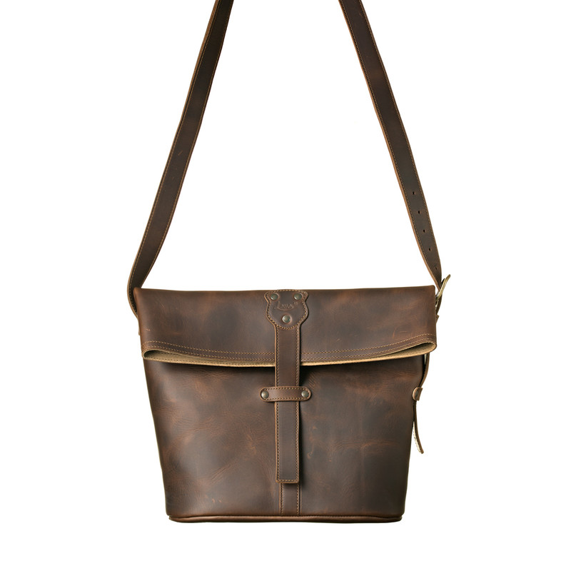 This is the front view of the fold over tote in dark brown