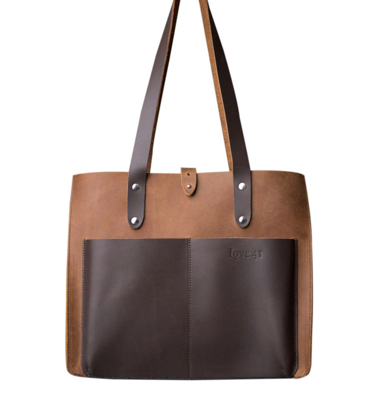 This is the brown leather tote with pockets showing the front view