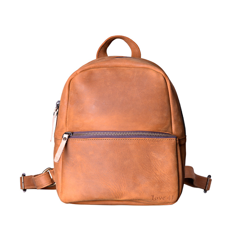 This tan brown women's leather backpack is showing the front.