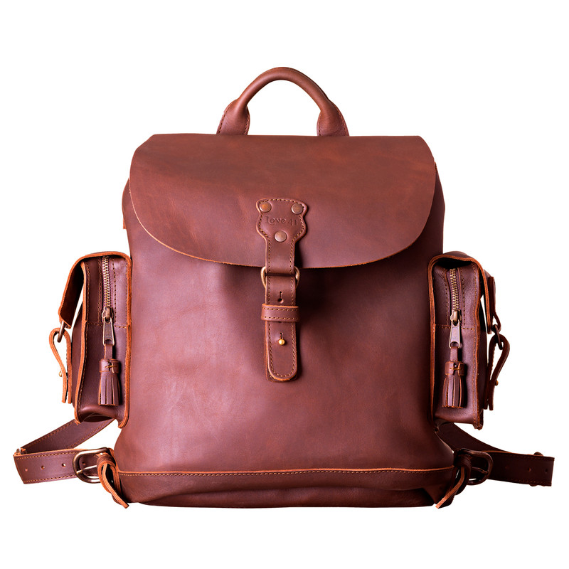 This red brown women's brown leather backpack is facing forward.