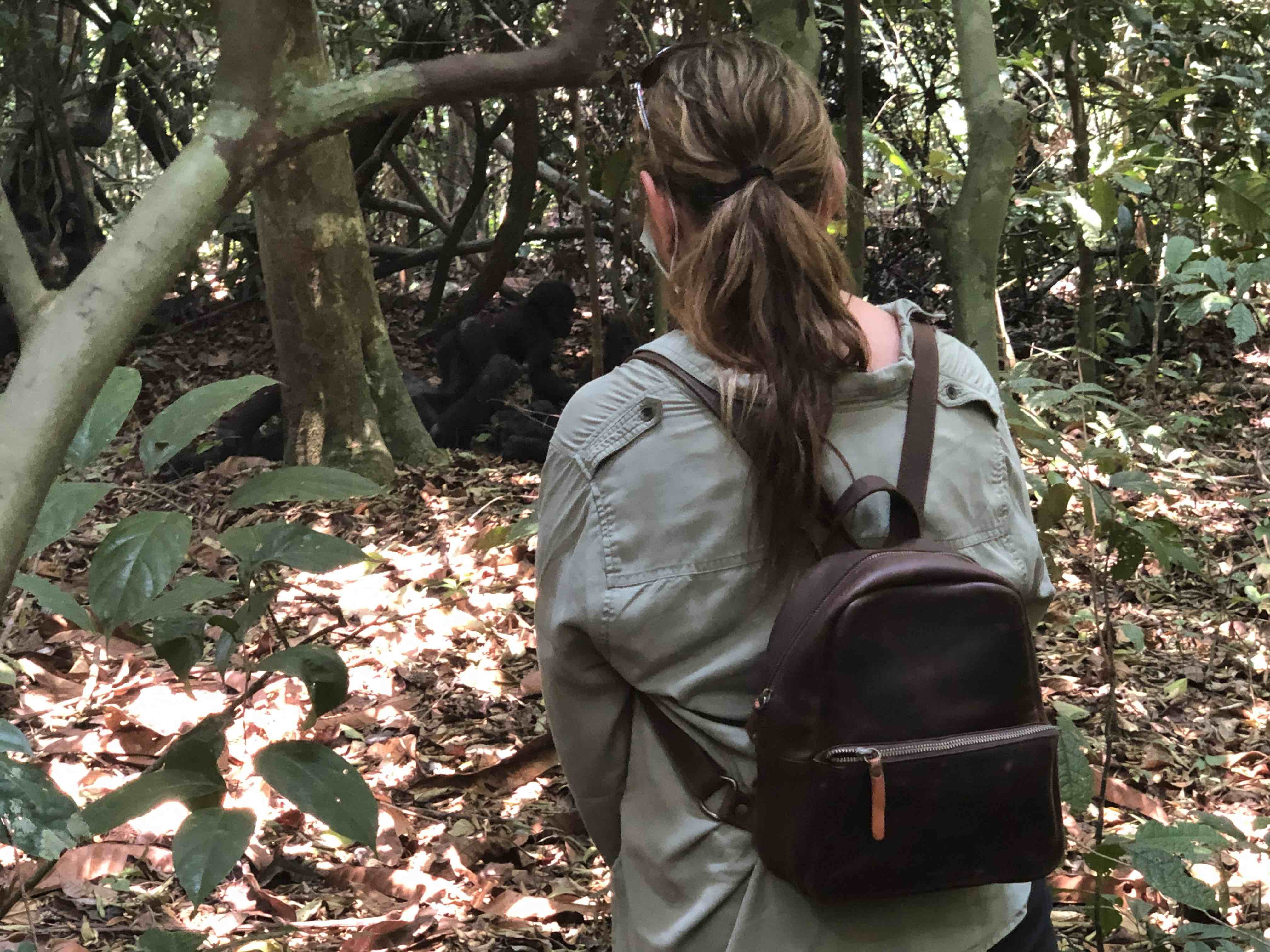 small leather women's backpack with a gorilla in front of the lady