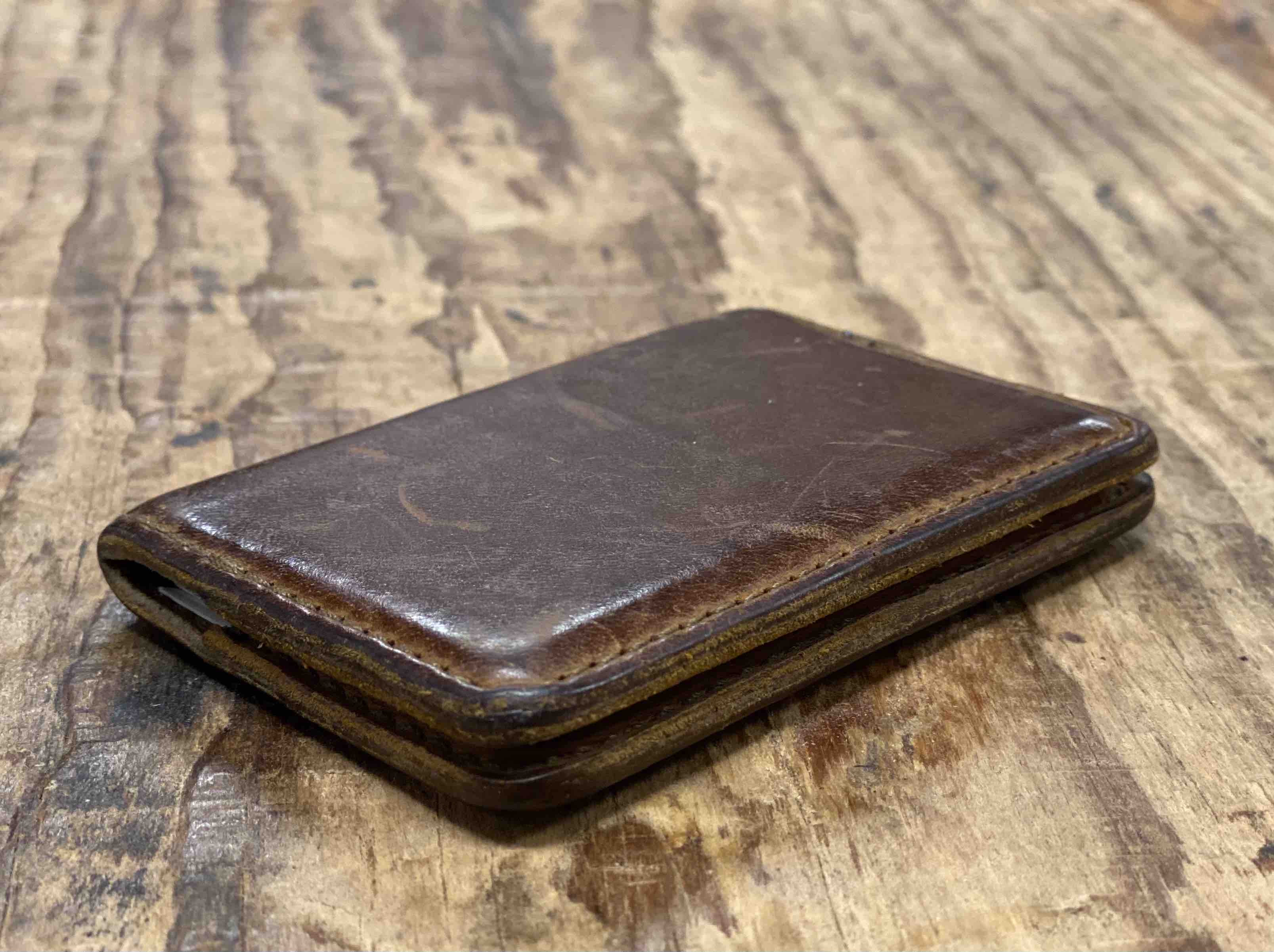 Leather business card holder that has been used and now has a nice patina. Some use it as a minimalist wallet