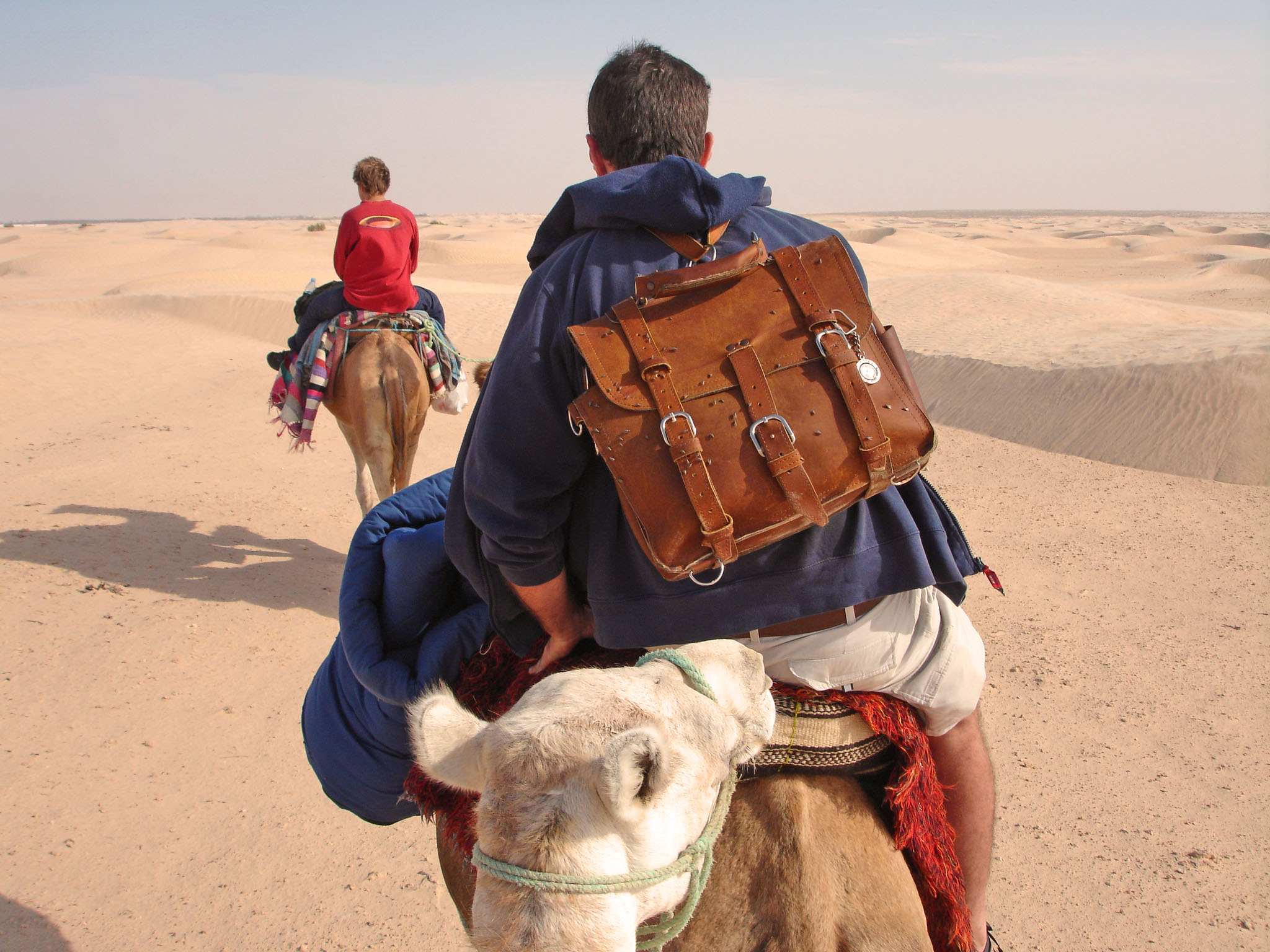 travel chess set in the sahara desert in leather satchel