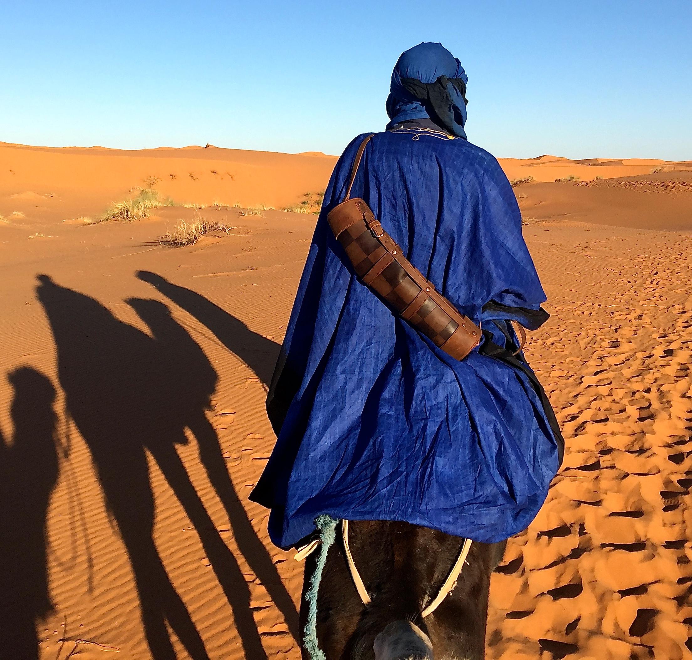 leather travel chess set in the Sahara Desert Morocco