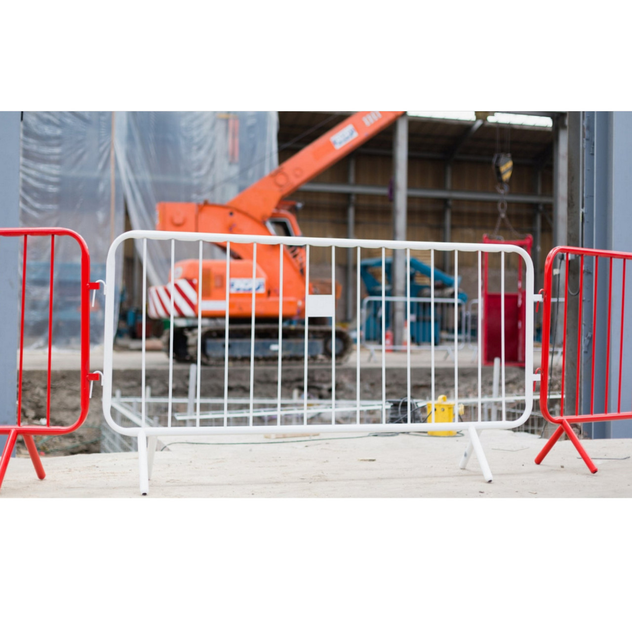 Red & white metal crowd control barriers