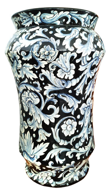 Painted ceramic umbrella stand with flower decoration and black background.