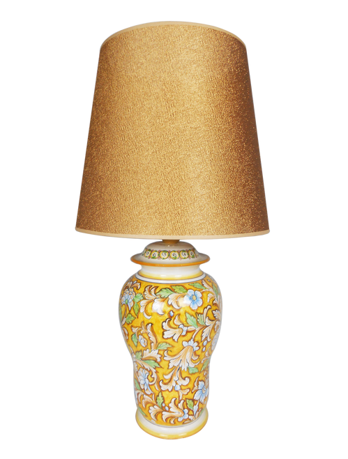 Ceramic lamp hand painted with a flower motif and yellow background