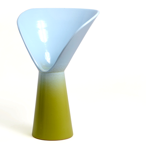 Vase of Design born from an idea by Luca Binaglia. Product with a contemporary look worked entirely by hand according to the principles of the ancient ceramic tradition of the MOD company in Deruta. The vase includes shades of light blue and light green.