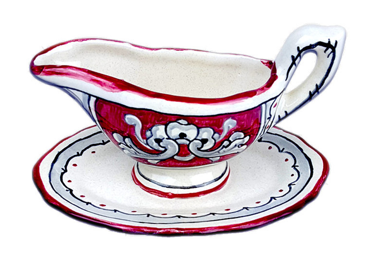 """Hand-painted sauce boat made in Italy with a deoration called """"600 red background""""."""
