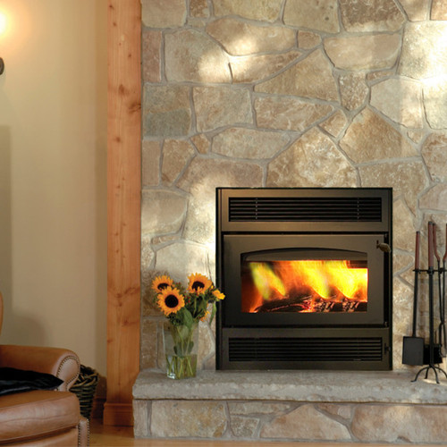 Z42 Zero Clearance Fireplace  The Z42 consists of applied modern technology and design to create a zero clearance fireplace to heat your home safely and efficiently. It is a wood-burning fireplace activated by lighting fuel and tinder inside a closed off area.  Zero Clearance Efficiency  Like its gas-burning counterparts, we have designed the Z42 to operate at the highest level of efficiency. This fireplace unit has a 60,000 BTU/hr input rate. With a minimum burn rate of 8,000 BTU per hour and a 77% efficiency rating, it also burns efficiently enough to heat your home as quickly as a gas fireplace. While it cannot be connected to your thermostat, a wood stove will burn at a temperature hot enough to spread heat throughout your space.  Zero Clearance Fireplace Safety Mechanics  As a zero clearance model, the Z42 can be safely lit in a closed space with a fire kit, tinder, and up to twenty-two inch long logs for fuel.