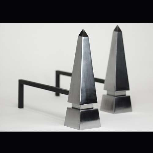 A Pair of Obelisk Steel Fire Dogs     Overall size 3 3/8'' (86mm) W x 12 1/4'' (311mm) H x 17 1/2'' (444mm) D