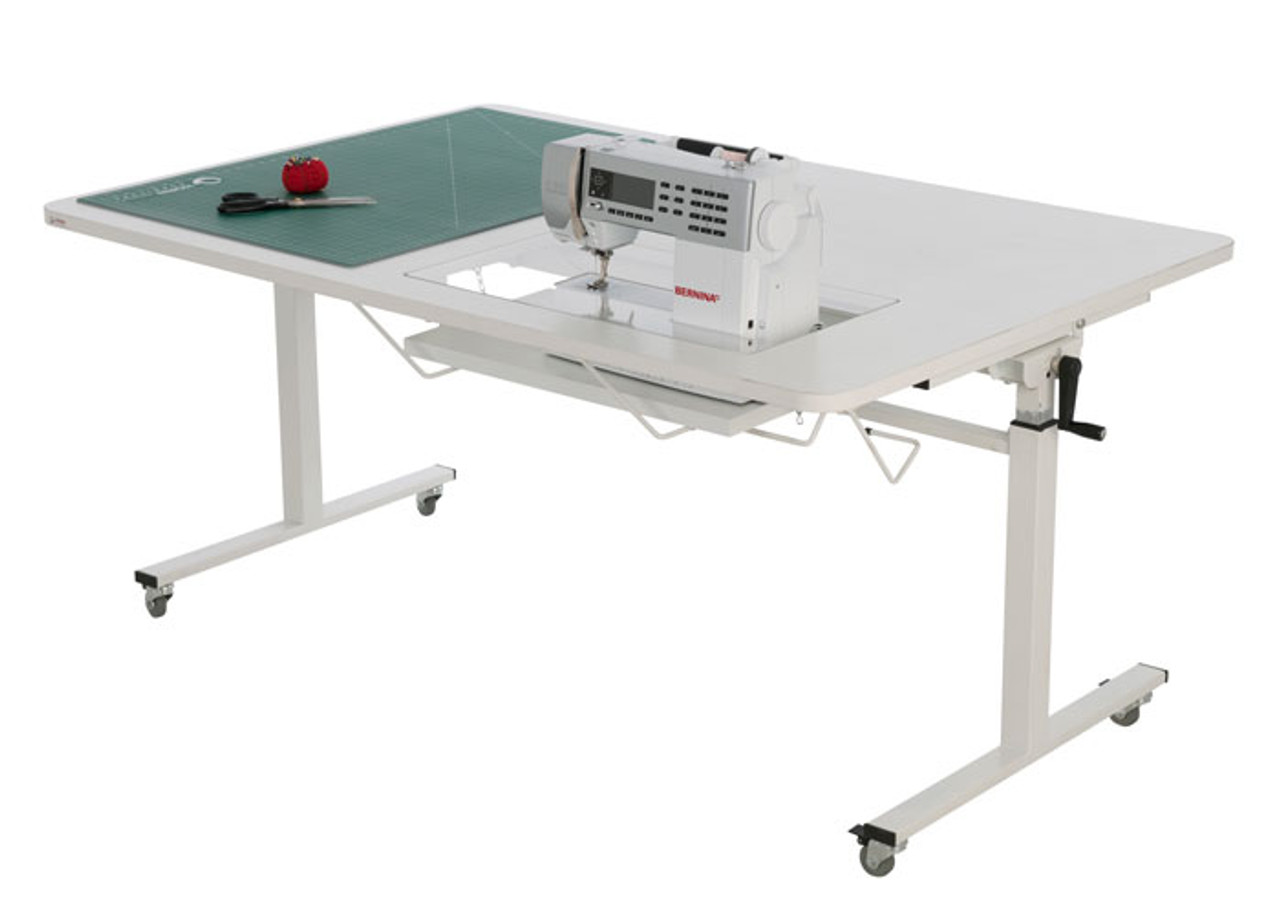 Height adjustable sewing/cutting table
