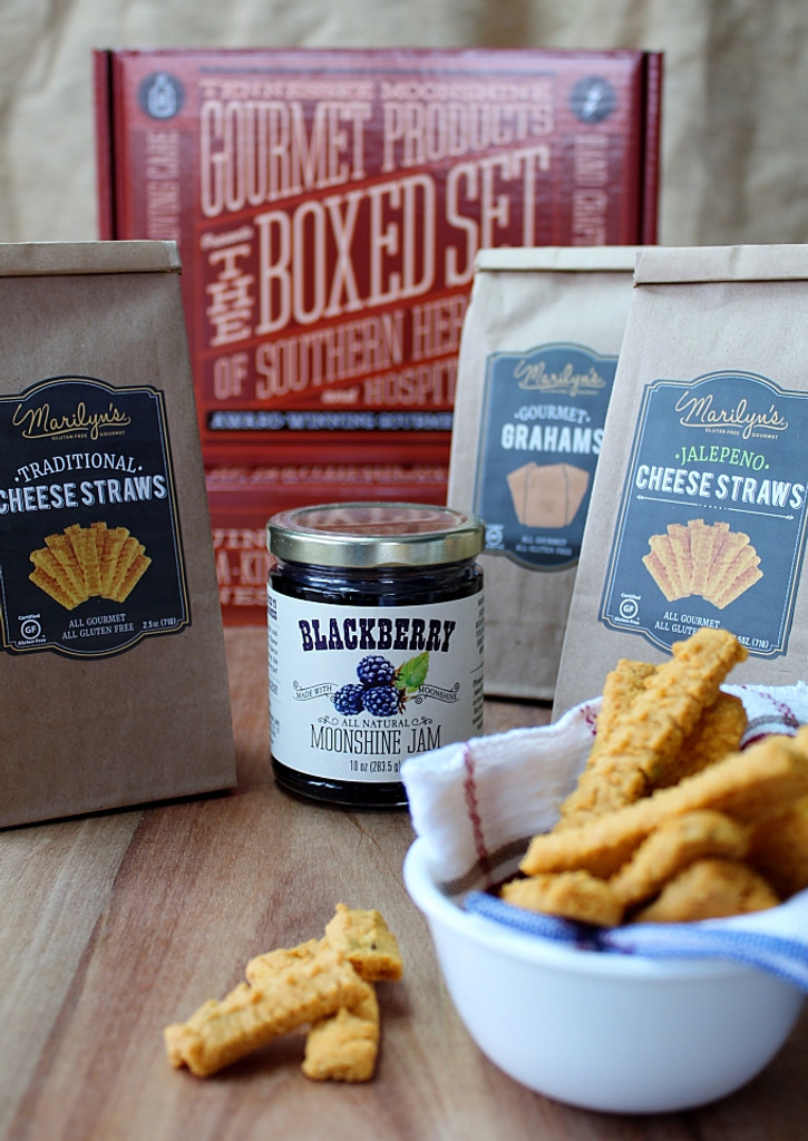 We have partnered with Marilyn's Gluten-Free Gourmet of Roswell, GA to introduce our newest gift box - a gluten-free collection of delectable cheese straws, graham crackers and our scrumptious jams! We were delighted to discover Marilyn's wonderful products, not only because they are certified gluten-free, but also because they are truly delicious! The jalapeno cheese straws are Bill's favorite and Ann loves the original cheese straws, while both of them adore the graham crackers! If you have a friend or family member who is gluten intolerant, this gift box is meant for them! You choose two jams and two gluten-free treats and we'll ship it right to your doorstep in our colorful gift box.