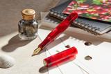 Kanilea Kona Cherry fountain pen, Classic profile, 14k gold-plated medallion, and 18k gold nib