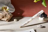 Kanilea Kona Snow ballpoint pen with 14k gold-plated medallion