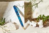 Kanilea Honokalani fountain pen, Classic Slim profile, 14k gold-plated medallion, and 18k gold nib, posted