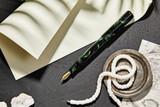Kanilea Manta fountain pen, Classic Slim profile, 14k gold-plated medallion, and 18k gold nib, posted