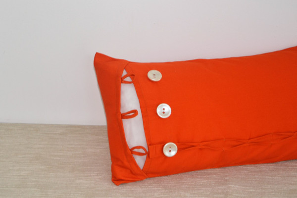 Orange Oblong Cushion Cover with Buttons & Ruffles Feature