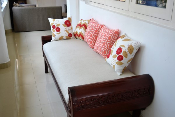 Red Throw pillows, Coral cushion covers, on daybed
