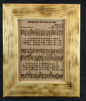 Amazing Grace Sheet Music Laser Engraved on a 8x10 sheet of high quality leather with a custom wood frame.  This style of frame can also be custom laser engraved for an additional fee.