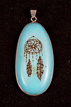 Laser engraved Turquoise pendant.
