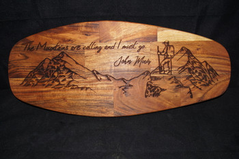 The mountains are calling and I must go. This quote by John Muir has been custom laser engraved on a high quality mango wood cutting board