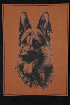 "5"" x 7"" synthetic leather piece laser engraved with a photo of a majestic German Shepherd dog. This is suitable from framing and would make a great gift for any German Shepherd lover."