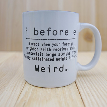 English is Weird....I Before E laser engraved coffee mug.  A funny saying showing some exceptions to the rule that I comes before E except after C.
