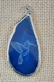 Beautiful laser engraved agate pendant featuring a hummingbird.
