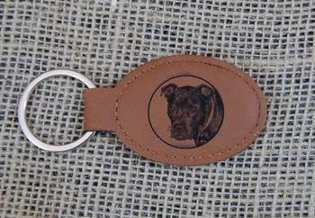Your photo engraved on leatherette keychain. This is the chestnut color.