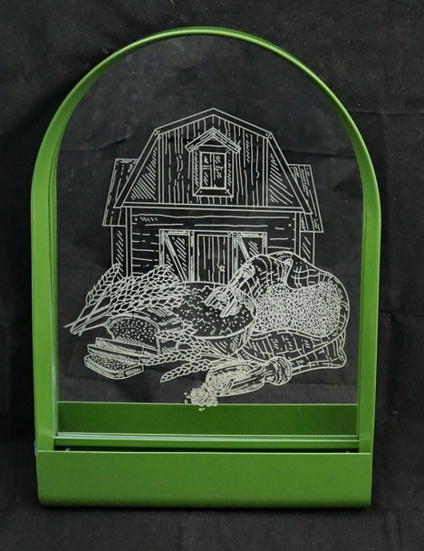 Green Metal Mirror Laser Engraved with a scene featuring a barn, wheat, grain and bread.