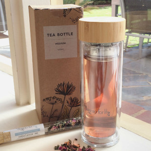 Organics for Lily - Medium Herbal Tea Bottle, shown with filter and sample tea test tube