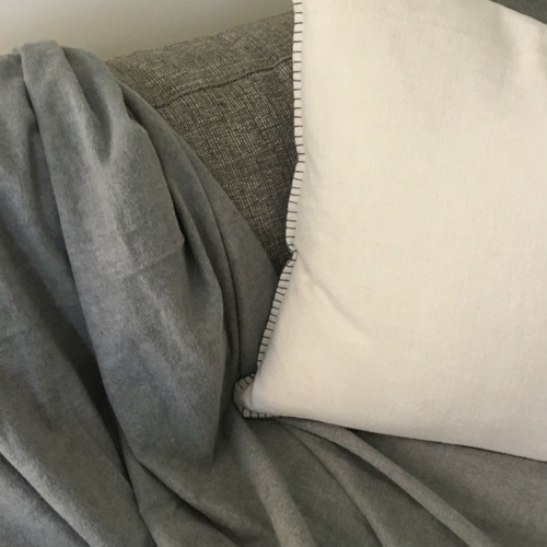Casetta Living - Blanket Stitched Blanket 170cm x 130cm - Charcoal shown with Blanket Stitched Cushion in Natural