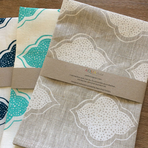 Linen Tea Towel - Lanterns Range showing Natural and White on top