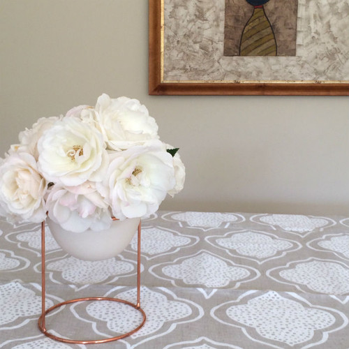Table Cloth - Lanterns Natural and White shown with Ivy Muse Nest Indoor Plant Pot stand in copper