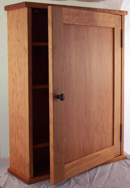 Surface mounted shaker style medicine cabinet with a shaker flat panel door. Shown in cherry with oil  rubbed bronze hardware.