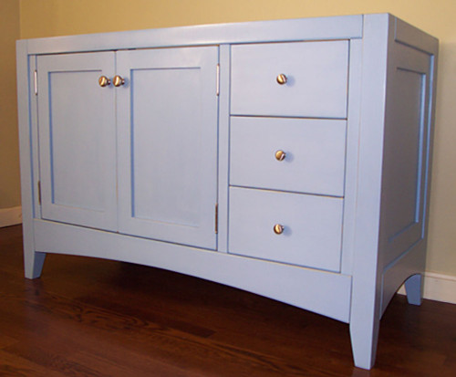 "48"" wide shaker style vanity. To give the vanity a heavier but dressier look 2 1/4"" legs were used instead of the standard 1 1/2"" legs, and larger arched base rails were used instead of the standard straight rails. Painted with Genuine Old-Fashioned Milk Paint; Federal Blue mixed with 75% Snow White."