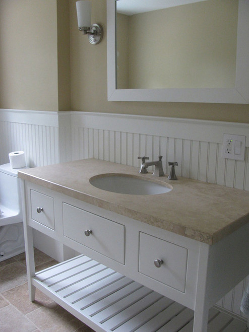 "The painted white open style bathroom vanity in the photo is 48"" wide, made from poplar, with a marble top, a slat shelf, a center false drawer and two functional drawers. As you can see from the photo, the white slat shelf blends beautifully with the bead board on the walls behind it."