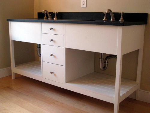 """This 65"""" wide open style double sink vanity is made from solid poplar, has 4 functional drawers with brushed nickel knobs, and is painted with Benjamin Moore's """"Chantilly Lace"""". The two shelves are side-to-side slats."""